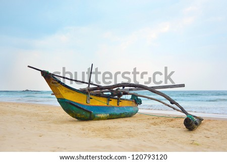 Fishing boat by the shore at Bentota Beach, Sri Lanka - stock photo