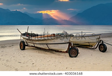 Fishing boat. Conceptual image symbolizing termination of true industrial fisheries - stock photo