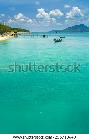Fishing boat floating in the sea on blue sky background.  Fishing boat floating. - stock photo