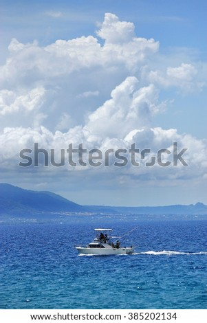 Fishing boat in deep blue ocean offshore in Dominican republic. - stock photo