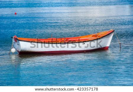 Fishing boat in Greece in sea near the beach - stock photo