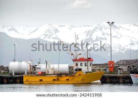 Fishing boat in Husavik harbor in Iceland - stock photo