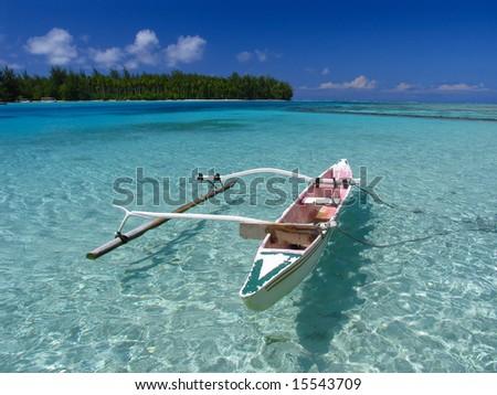 Fishing boat in Moorea beach. Polynesia. - stock photo