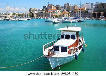 Fishing boat in port of Heraklion, Crete Island, Greece - stock photo