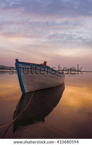 Fishing boat in sea after sunset