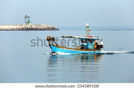 Fishing boat in the adriatic sea in Italy - stock photo