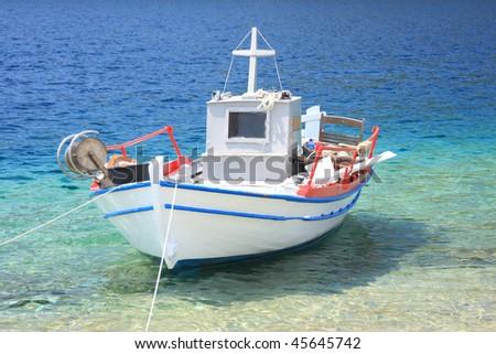 Fishing boat in the Aegean sea in Greece - stock photo