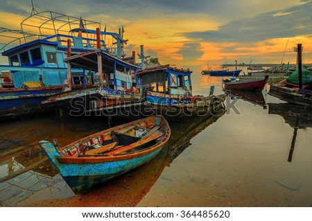 fishing boat in the golden morning light. - stock photo