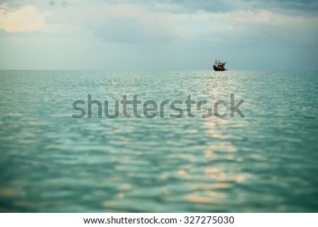 Fishing boat in the ocean  - stock photo