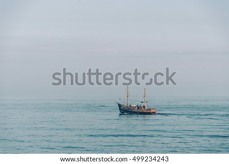 Fishing boat in the sea at serene weather