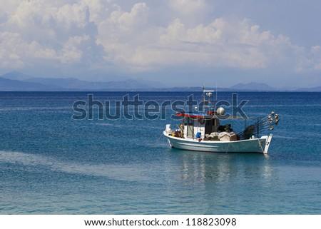 Fishing boat in the sea in Greece - stock photo