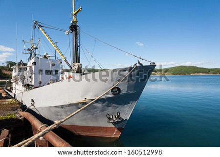 Fishing boat is moored in the harbor. - stock photo