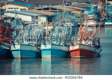 Fishing boat is out fishing. Fishermen is a career that has been popular in the seaside city of Thailand. , process in vintage style - stock photo