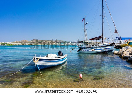 Fishing boat moored on the beach at Faliraki Rhodes Dodecanese Greece  Europe