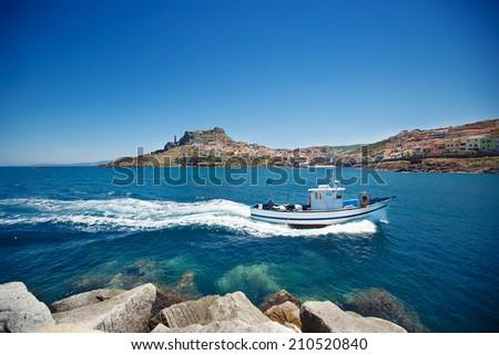 Fishing boat near town Castelsardo, Sardinia - stock photo