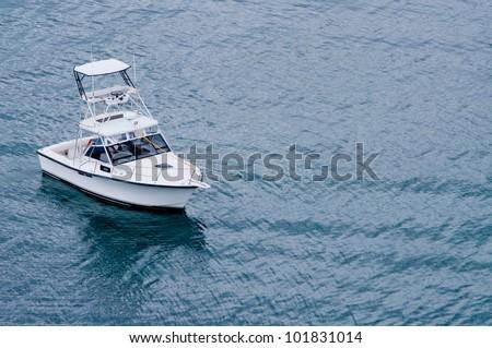 Fishing boat off the coast of Roatan - stock photo