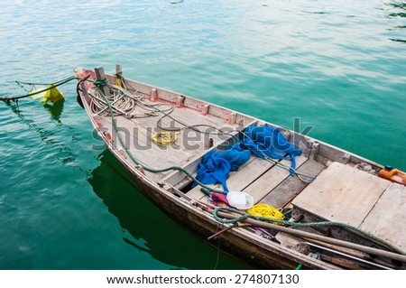 fishing boat on a calm sea.