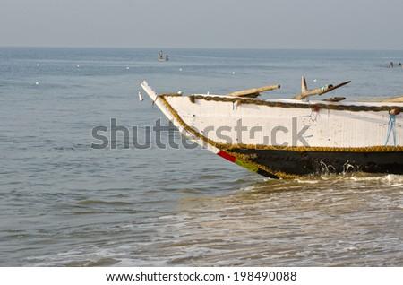 fishing boat on Bengal sea beach, Puti, Tamil Nadu, India - stock photo