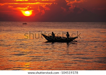 Fishing boat on  Sri Lanka at sunset - stock photo