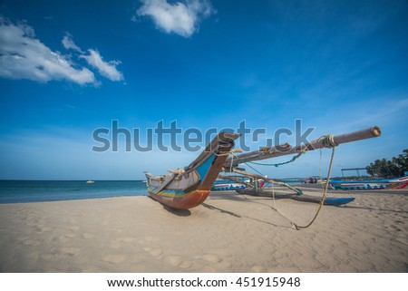 Fishing boat on the beach in Trincomalee, Sri Lanka - stock photo