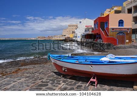 Fishing boat on the beach of El Medano village, Tenerife, Canary Islands, Spain - stock photo