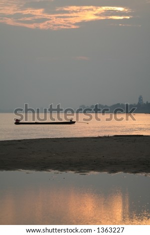 Fishing Boat on the Mekong in Laos - stock photo