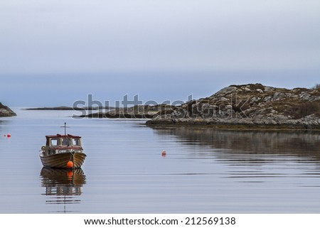 Fishing boat on the Norwegian Atlantic Coast - stock photo