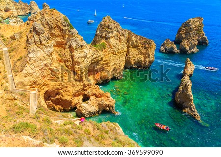 Fishing boat on turquoise sea water at Ponta da Piedade, Algarve region, Portugal - stock photo