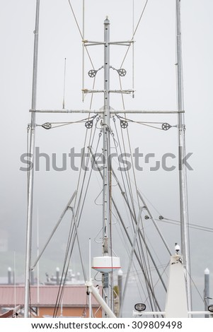 Fishing boat rigging in Foggy, misty Alaska - stock photo