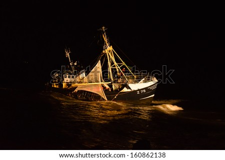 fishing boat run aground on the Dutch coast - stock photo