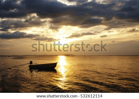 Fishing boat Thai style in the morning, sunset sunrise at sea, black cloud