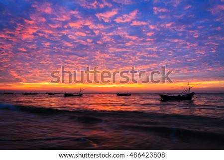Fishing boat with colorful cloud during Sunrise