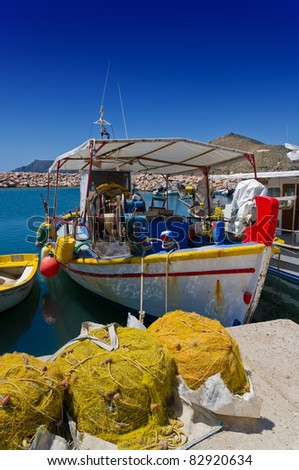 fishing boat with fishing net - stock photo