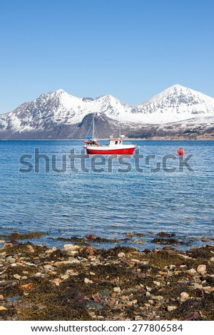 Fishing boat with snowy mountain in background