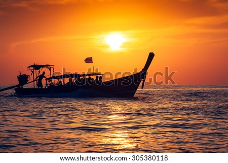 Fishing boat with sunset in phi phi islands,Thailand - stock photo