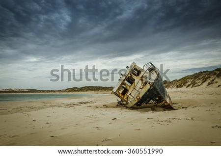Fishing boat wrecking on the beach