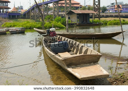 Fishing boats along the banks of the river - stock photo