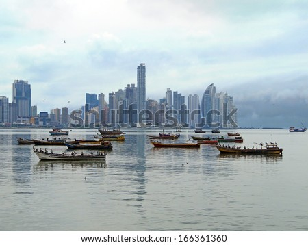 Fishing boats anchored and skyscrapers in background, Panama City , Panama, Central America - stock photo