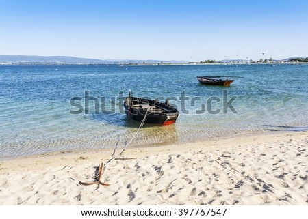 Fishing boats anchored on Riason beach in Arousa Island