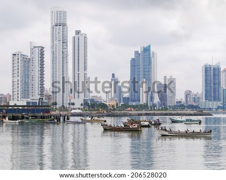 Fishing boats anchored with skyscrapers of Panama City, Pacific coast, Central America - stock photo
