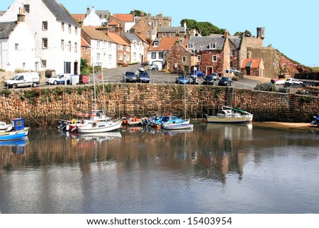 fishing boats and cruisers in crail harbour