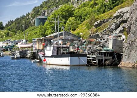 Fishing boats and fishing shacks in Quidi Vidi, outside of St. John's, Newfoundland. - stock photo