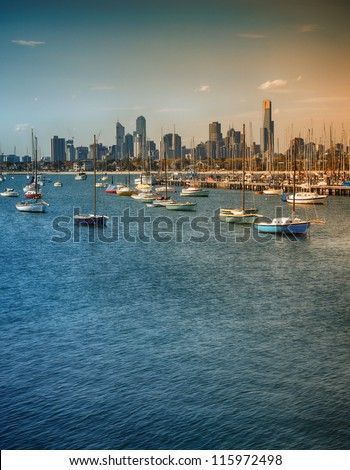 Fishing boats and the view of Melbourne City on sunset - stock photo