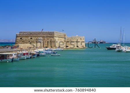Fishing boats and Venetian Fortress in Heraklion Crete Island, Greece