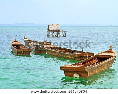 Fishing boats are in the South China Sea from Bintan Island, Indonesia.  - stock photo
