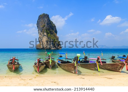 Fishing boats are used to Transfer tourists between the islands. Taken from Krabi, Thailand