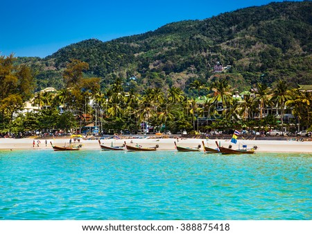 Fishing boats at Patong beachin Phuket, Thailand. Phuket is a popular destination famous for its beaches. - stock photo