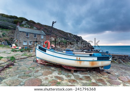 Fishing boats at Penberth Cove on the South West Coast Path near Land's End in Cornwall - stock photo