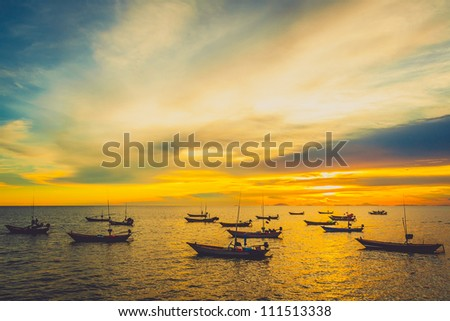 Fishing boats at sunset in Chantaburi, Thailand - stock photo