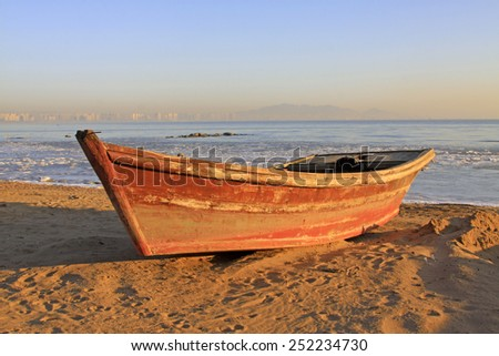 fishing boats by the sea in winter, closeup of photo